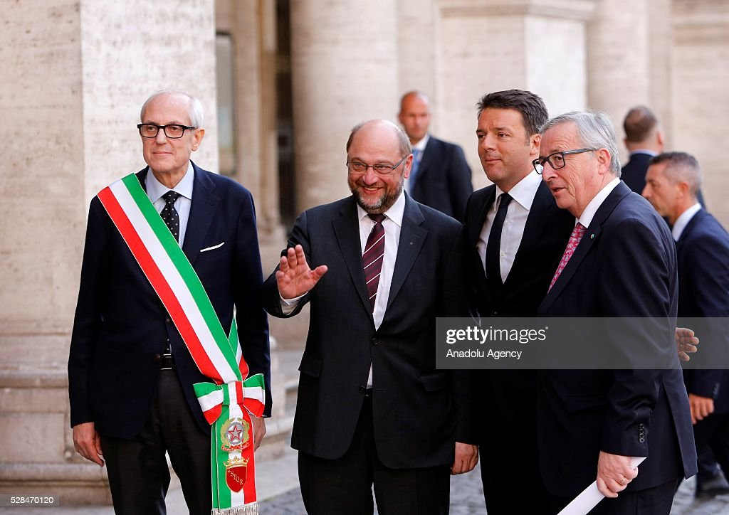 Rome's Commissioner Francesco Paolo Tronca, EU Parliament's speaker Martin Schulz, Italian Premier Matteo Renzi and EU Commission president Jean-Claude Juncker greet media as they arrive in Piazza del Campidoglio to attend a conference on the state of the European Union at the Capitoline Museum in Rome, May 5, 2016.