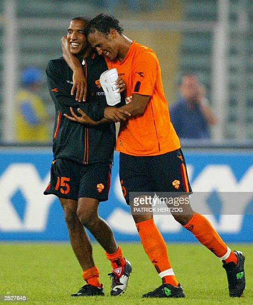 Rome's defender French Jonathan Zebina is congratulated by compatriot and teammate Olivier Dacourt after he scored the equalizing goal for his team...