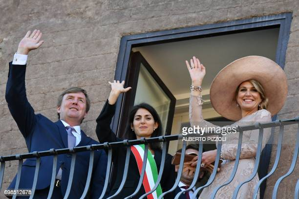 Rome's mayor Virginia Raggi King WillemAlexander and Queen Maxima of Netherlands wave from the balcony of Rome City Hall during their meeting on June...