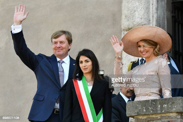 Rome's mayor Virginia Raggi welcomes King WillemAlexander and Queen Maxima of Netherlands as they arrive at Rome City Hall for a meeting on June 20...