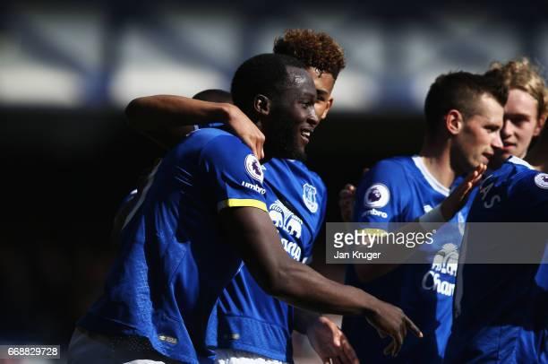 Romeu Lukaku of Everton celebrates scoring his sides third goal with his Everton team mates during the Premier League match between Everton and...