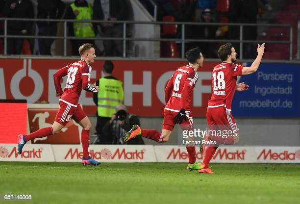 Romian Bregerie of FC Ingolstadt and his teammates celebrate their side's second goal during the Bundesliga match between FC Ingolstadt 04 and 1 FC...