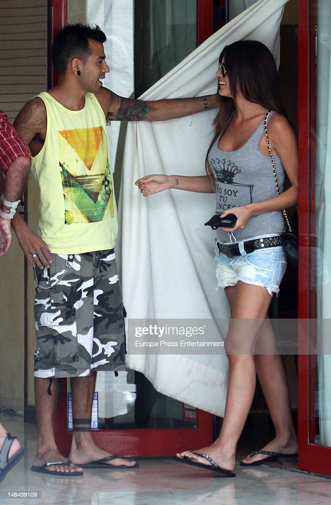 Romina Belluscio as Spanish footballplayer Guti has her name tattooed on his fingers on July 16 2012 in Ibiza Spain