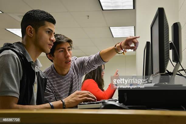 Rommel Romano L a Washington Lee High School student gets help writing his college essay from volunteer Rodrigo Ventiades as high school students who...