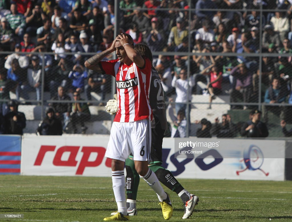 Román Martínez of Estudiantes de La Plata fights for the ball during a match between San Martin de San Juan and Estudiantes de La Plata as part of the Torneo Final 2013 at the Ingeniero Hilario Sanchez stadium on June 15 2013 in San Juan, Argentina.