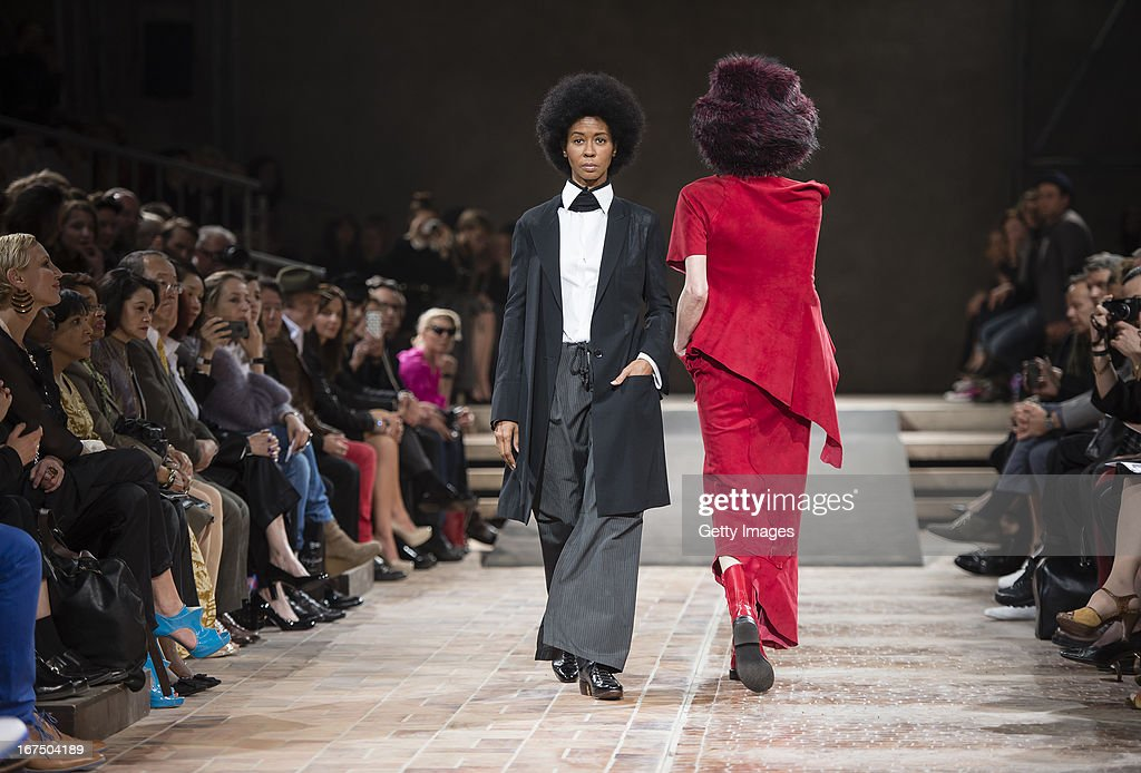 Romney Mueller-Westernhagen (L), wife of singer Marius Mueller-Westerhagen, walks the runway during the Yohji Yamamoto fashion show 'Cutting Age' at St. Agnes Church on April 25, 2013 in Berlin, Germany.