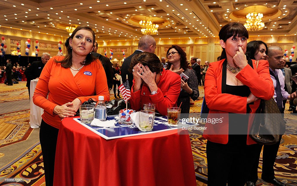 Romney supporters Cecilia Aldana, Julie Hereford and Irma Aguirre reacts after hearing that President Barack Obama was declared the winner at an election night watch party at The Venetian on November 6, 2012 in Las Vegas, Nevada. Voters went to polls in the heavily contested presidential race between incumbent U.S. President Barack Obama and Republican challenger Mitt Romney.