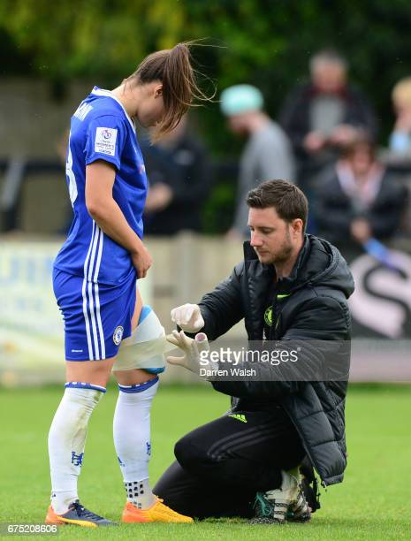 Romona Bachmann of Chelsea recieving medical treatment during the FA WSL 1 match between Chelsea Ladies and Yeovil Town Ladies at Wheatsheaf Park on...