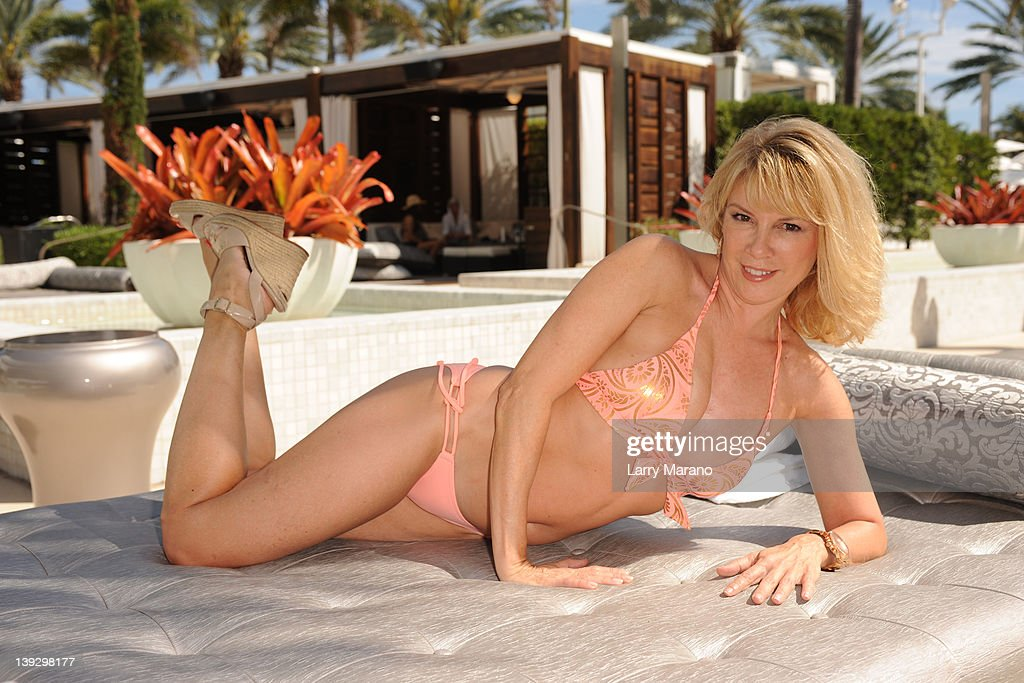 Romona Singer of 'The Real Housewives of New York' who is in town to promote her Ramona Pinot Grigio poses poolside at Fontainebleau Miami Beach on...