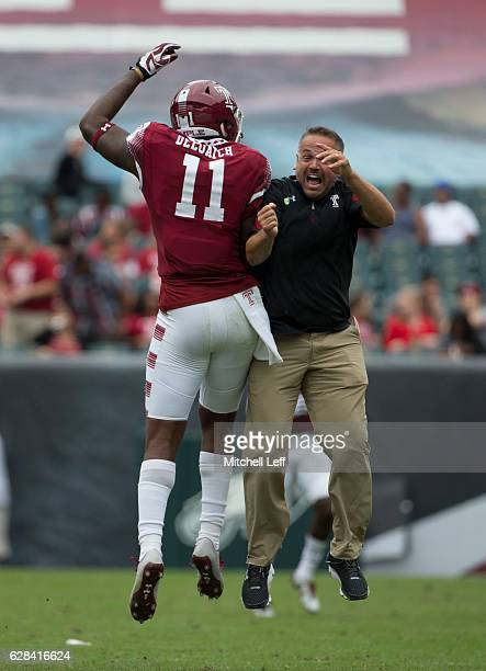 Romond Deloatch and head coach Matt Rhule of the Temple Owls celebrate against the Charlotte 49ers at Lincoln Financial Field on September 24 2016 in...