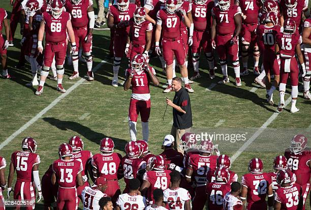 Romond Deloatch of the Temple Owls and head coach Matt Rhule stand in the middle of the huddle prior to the game against the Cincinnati Bearcats at...