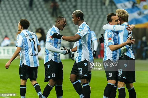 Romuald Lacazette of 1860 Muenchen Ribamar of 1860 Muenchen Michael Liendl of 1860 Muenchen Stefan Aigner of 1860 Muenchen celebrate their win during...