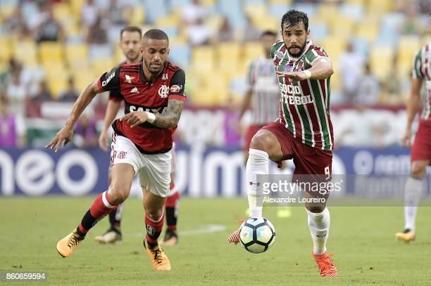 Romulo of Flamengo battles for the ball with Henrique Dourado of Fluminense during the match between Flamengo and Fluminense as part of Brasileirao...