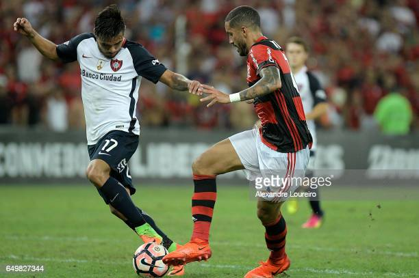 Romulo of Flamengo battles for the ball with Paulo Diaz of San Lorenzo during the match between Flamengo and San Lorenzo as part of Copa Bridgestone...