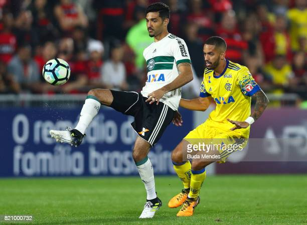 Romulo of Flamengo struggles for the ball with Alan Santos of Coritiba during a match between Flamengo and Coritiba as part of Brasileirao Series A...
