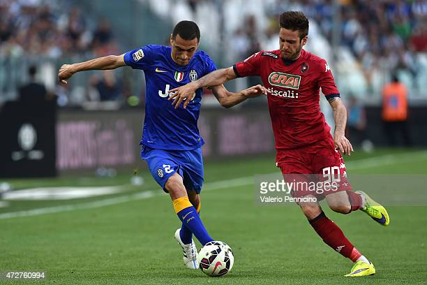 Romulo of Juventus FC is challenged by Duje Cop of Cagliari Calcio during the Serie A match between Juventus FC and Cagliari Calcio at Juventus Arena...