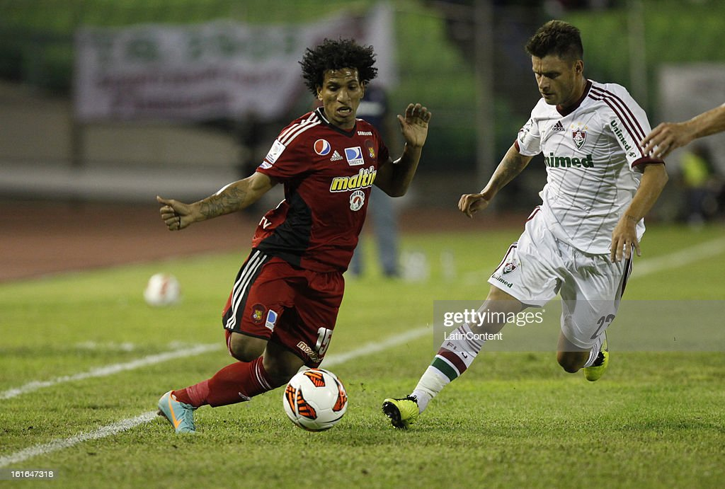 Romulo Otero de Caracas FC fights for the ball during a match between Caracas FC and Fluminense as part of the 2013 Copa Bridgestone Libertadores at the Olympic Stadium on February 13, 2013 in Caracas, Venezuela.