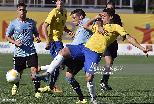 Romulo Pacheco of Brazil vies for the ball with Erick Cabaco of Uruguay during their semifinal match of the Pan American Games in Hamilton Canada on...