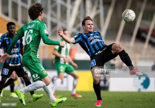 Romulo Pereira Pintoof Hammarby IF and Niklas Busch Thor of IK Sirius FK during the Allsvenskan match between IK Sirius FK and Hammarby IF at...