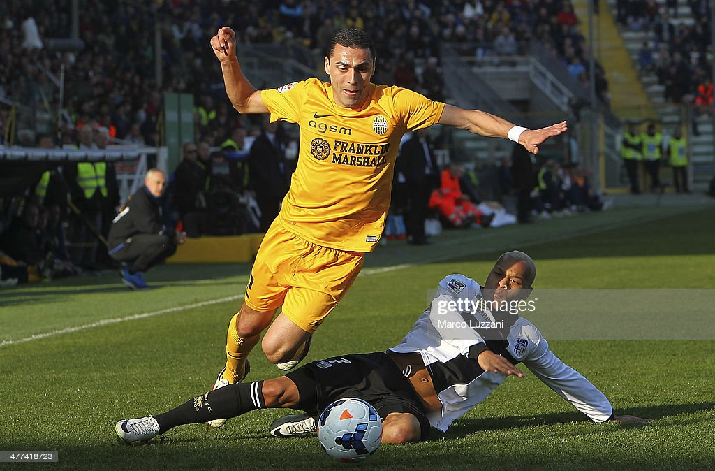 Romulo Souza of Hellas Verona FC is challenged by Jonathan Biabiany of Parma FC during the Serie A match between Parma FC and Hellas Verona FC at...