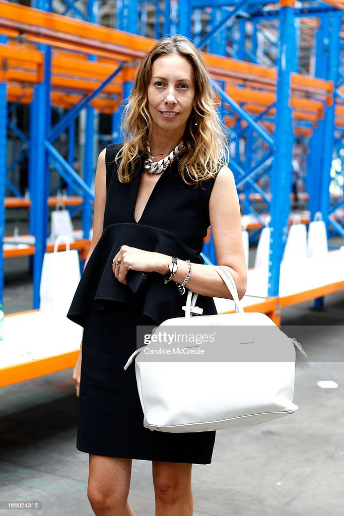 Romy Freedman wears a Celine dress and carries a bag by Prada, sunglasses by Ellery at Mercedes-Benz Fashion Week Australia Spring/Summer 2013/14 at Carriageworks on April 8, 2013 in Sydney, Australia.