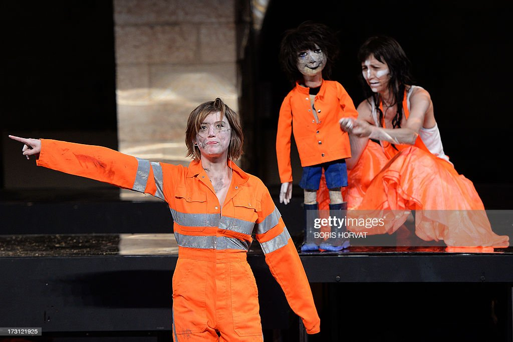 Romy Louise Lauwers (L) and Grace Ellen Barkey perform a play written and directed Belgian Jan Lauwers 'Place du marché 76' on July 7, 2013 in Avignon, during the 67th International Theatre festival.