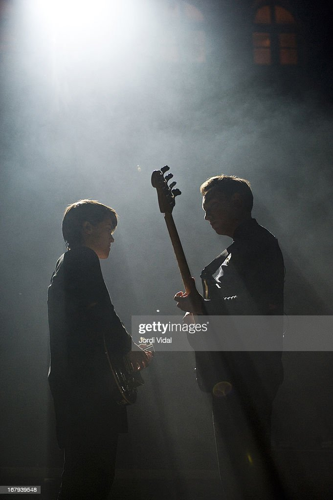 Romy Madley Croft and Oliver Sim of The XX perform on stage at Poble Espanyol on May 2, 2013 in Barcelona, Spain.
