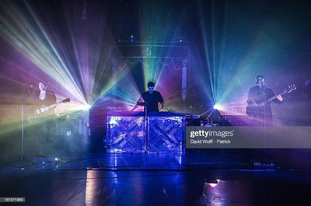 Romy Madley Croft, Jamie Smith and Oliver Sim from The XX Perform at Le Cirque d'Hiver on September 6, 2012 in Paris, France.