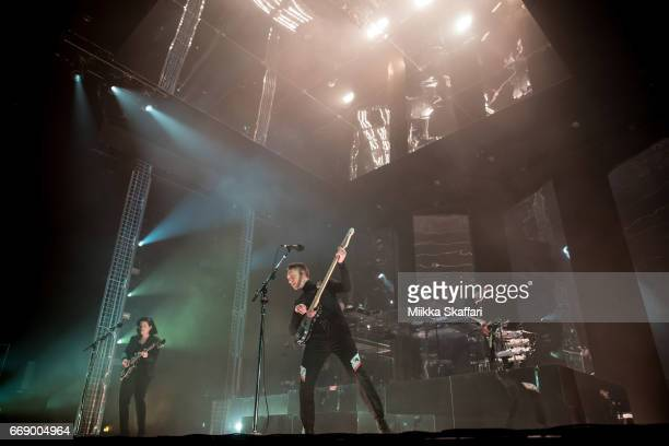 Romy Madley Croft Oliver Sim and Jamie Smith of The XX perform at Bill Graham Civic Auditorium on April 15 2017 in San Francisco California