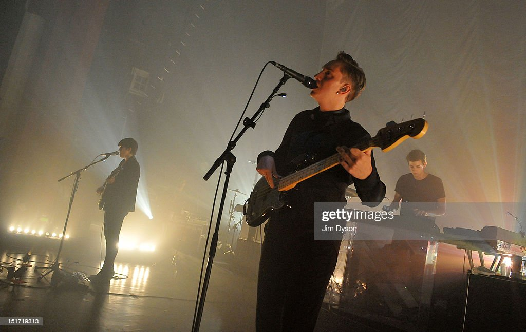 Romy Madley Croft, Oliver Sim and Jamie Smith of The XX perform live on stage at Shepherds Bush Empire to support the release of their second album, Coexist, on September 10, 2012 in London, United Kingdom.