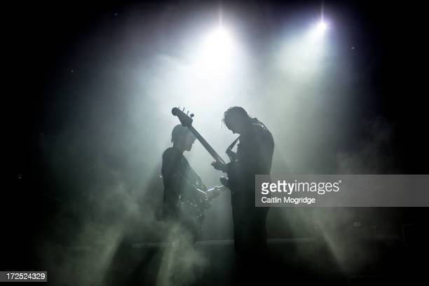 Romy Madley Croft Oliver Sim and Jamie Smith of The XX perform on stage at The Eden Project on July 2 2013 in St Austell England