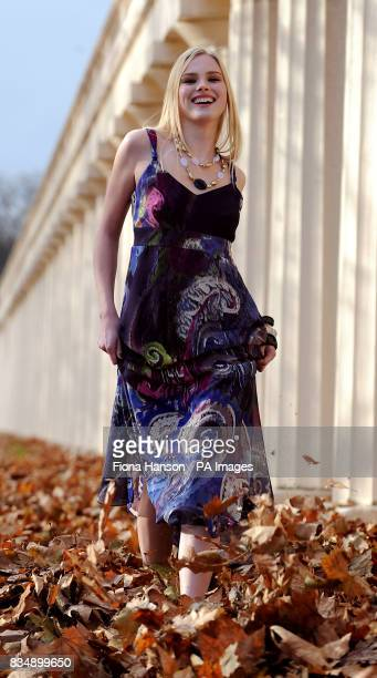Romy models clothing from Marks and Spencer's Per Una Spring 2009 range in London The model is wearing a maxi dress purple paisley beauty for 55