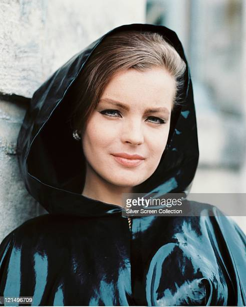 Romy Schneider Austrian actress wearing a dark plastic raincoat with the hood up circa 1970