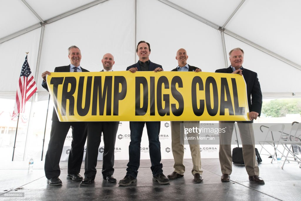 Ron Aldom, executive director of the Somerset County Chamber of Commerce, Carl Metzgar, PA State Representative, George Dethlefsen, CEO Corsa Coal Corp., Pat Stefano, PA State Senator, and Scott Wagner, PA State Senator hold up a 'Trump Digs Coal' sign at the grand opening of Corsa Coal's Acosta Deep Mine on June 8, 2017 in Friedens, Pennsylvania. The mine is expected to create more than 70 new jobs and should produce 400,000 tons of metallurgical coal a year.