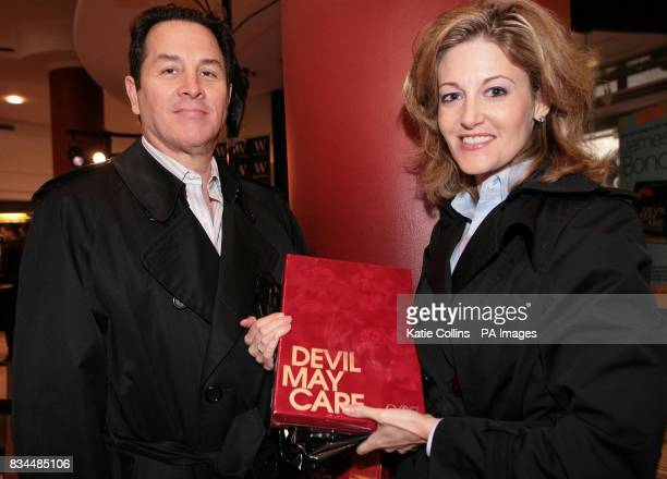 Ron and Tanya Correa from Washington DC with their special edition of the James Bond novel 'Devil May Care''at Waterstones Piccadilly