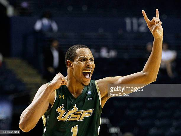 Ron Anderson Jr #1 of the South Florida Bulls celebrates after defeating the Temple Owls during the second round of the 2012 NCAA Men's Basketball...