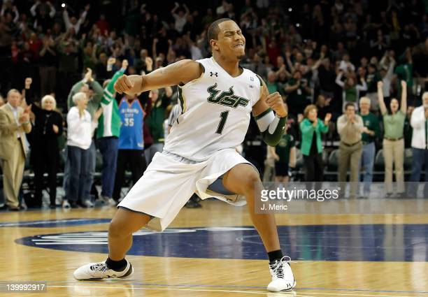 Ron Anderson Jr #1 of the South Florida Bulls celebrates his team's victory over the Cincinnati Bearcats at the Tampa Bay Times Forum on February 26...