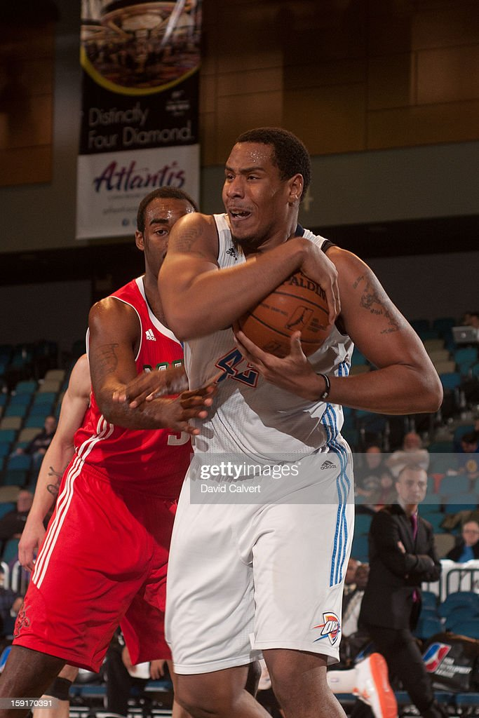 Ron Anderson #42 of the Tulsa 66ers fights to maintain possession from DaJuan Summers #34 of the Maine Red Claws during the 2013 NBA D-League Showcase on January 7, 2013 at the Reno Events Center in Reno, Nevada.