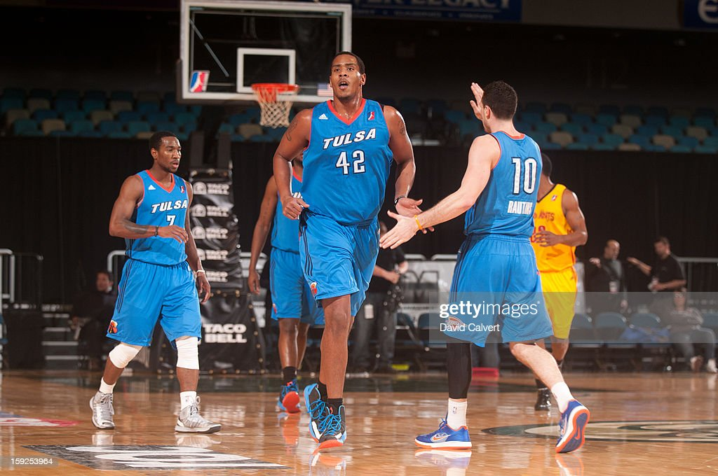 Ron Anderson #42 of the Tulsa 66ers greets teammate <a gi-track='captionPersonalityLinkClicked' href=/galleries/search?phrase=Andy+Rautins&family=editorial&specificpeople=784491 ng-click='$event.stopPropagation()'>Andy Rautins</a> #10 after a basket against the Fort Wayne Mad Ants during the 2013 NBA D-League Showcase on January 10, 2013 at the Reno Events Center in Reno, Nevada.