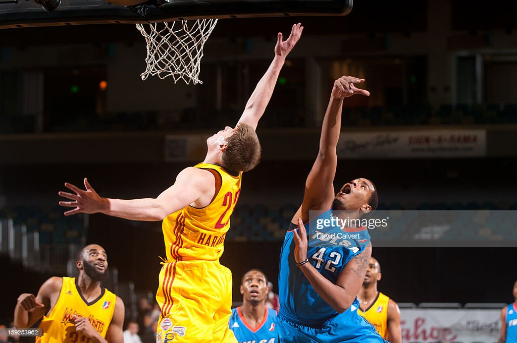 Ron Anderson #42 of the Tulsa 66ers shoots over <a gi-track='captionPersonalityLinkClicked' href=/galleries/search?phrase=Luke+Harangody&family=editorial&specificpeople=4094380 ng-click='$event.stopPropagation()'>Luke Harangody</a> #22 of the Fort Wayne Mad Ants during the 2013 NBA D-League Showcase on January 10, 2013 at the Reno Events Center in Reno, Nevada.