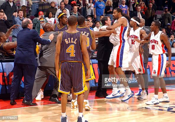Ron Artest and other members of the Indiana Pacers scuffle with members of the Detroit Pistons during a melee involving fans at a game against the...