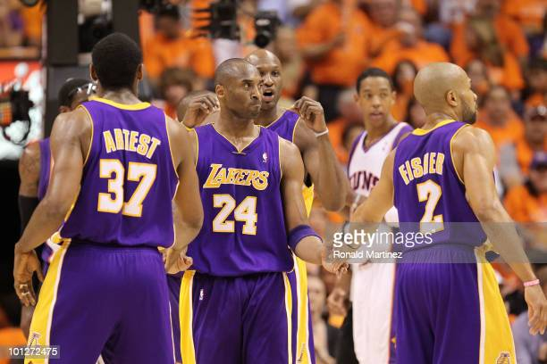 Ron Artest Kobe Bryant Lamar Odom and Derek Fisher of the Los Angeles Lakers celebrate a play against the Phoenix Suns in the third quarter of Game...