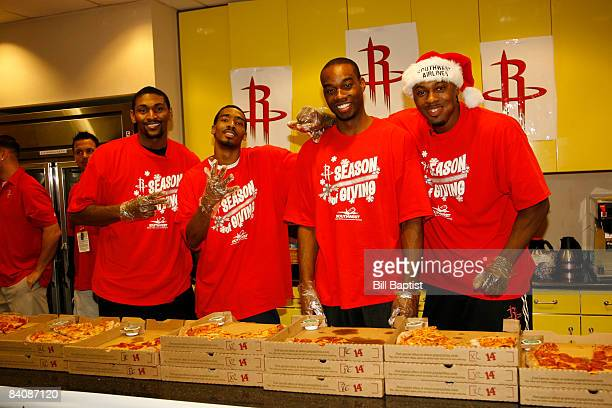Ron Artest Luther Head Carl Landry and Joey Dorsey of the Houston Rockets pass out gifts to the kids at The Ronald McDonald House during the Houston...