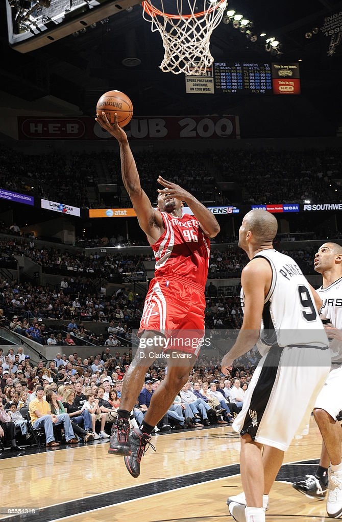 Ron Artest #96 of the Houston Rockets shoots against Tony Parker #9 of the San Antonio Spurs on March 22, 2009 at the AT&T Center in San Antonio, Texas.