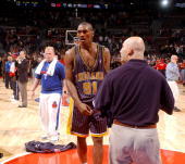 Ron Artest of the Indiana Pacers is shown on the court during a melee involving fans during a game against the Detroit Pistons November 19 2004 at...