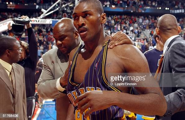 Ron Artest of the Indiana Pacers leaves the floor after a melee involving fans during a game against the Detroit Pistons November 19 2004 at the...