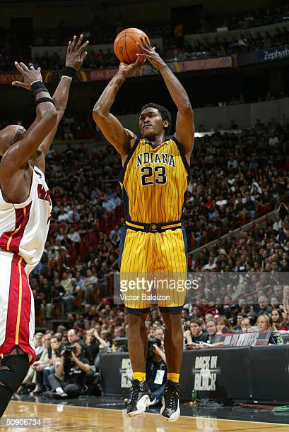Ron Artest of the Indiana Pacers shoots a jumper over Lamar Odom of the Miami Heat in Game six of the Eastern Conference Semifinals during the 2004...