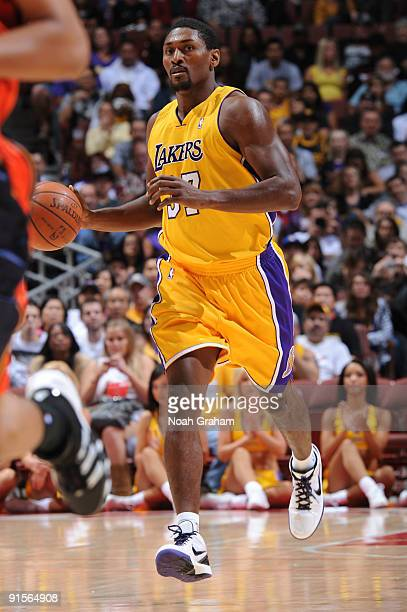 Ron Artest of the Los Angeles Lakers brings the ball up court against the Golden State Warriors during a preseason game at Honda Center on October 7...
