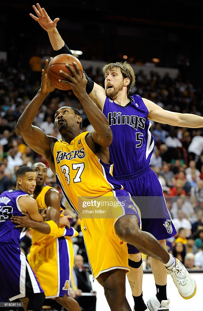 <a gi-track='captionPersonalityLinkClicked' href=/galleries/search?phrase=Ron+Artest&family=editorial&specificpeople=201763 ng-click='$event.stopPropagation()'>Ron Artest</a> #37 of the Los Angeles Lakers drives against <a gi-track='captionPersonalityLinkClicked' href=/galleries/search?phrase=Andres+Nocioni&family=editorial&specificpeople=201854 ng-click='$event.stopPropagation()'>Andres Nocioni</a> #5 of the Sacramento Kings during their preseason game at the Thomas & Mack Center October 15, 2009 in Las Vegas, Nevada.