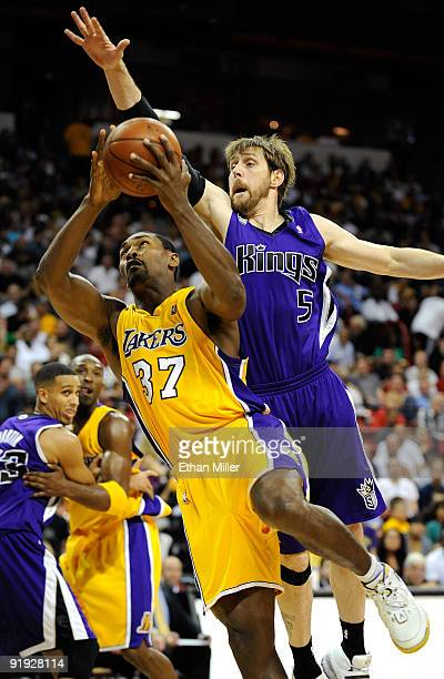 Ron Artest of the Los Angeles Lakers drives against Andres Nocioni of the Sacramento Kings during their preseason game at the Thomas Mack Center...
